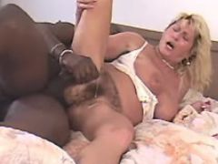 Blonde granny gets cumload on pussy from black guy