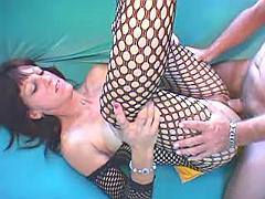 Old whore in fishnet wear is nailed