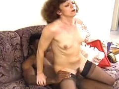 Aged housewife riding black sausage