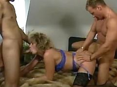 Mature lady sucking cocks n fucking with two guys