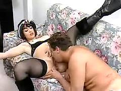 Retro chick in high leather boots gets off on sofa