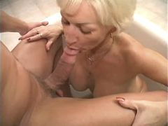 Blonde mature and guy have oral fuck in jacuzzi