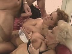 Two matures get cumshot on big tits after hot orgy