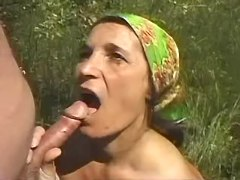 Old country woman sucking in nature