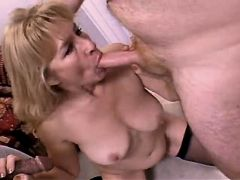 Blonde mature sucks two cocks and fucks in orgy