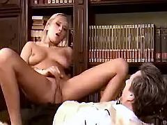 Sexy blonde secretary jumps on dick in office
