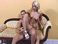 Vigorous hunk fucking w slender blond girl on sofa