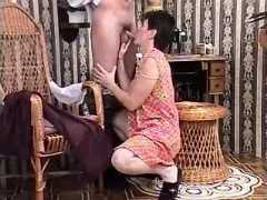 Mature dressmaker has fun with client in workshop