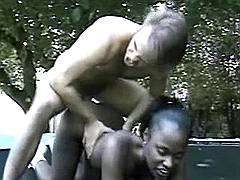 Playful ebony fucking on trampoline