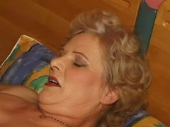 Man licks out plump granny with big tits in bed